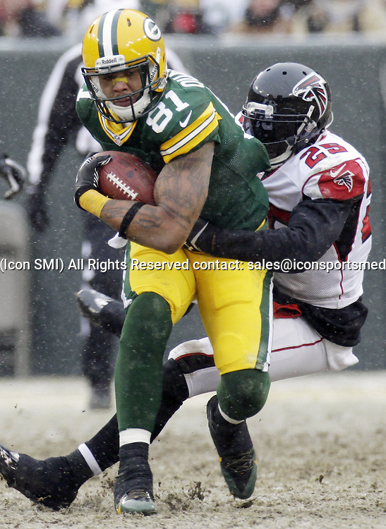 Dec. 8, 2013 - Green Bay, WI, USA - Green Bay Packers tight end Andrew Quarless (81) picks up 21 yards on a reception before being tackled by Atlanta Falcons safety William Moore (25) during the third quarter at Lambeau Field in Green Bay, Wis., on Sunday, Dec. 8, 2013. Packers defeated the Falcons, 22-21