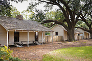 Slave quarters at Oak Alley plantation antebellum mansion house by Mississippi at Vacherie, Louisiana, USA