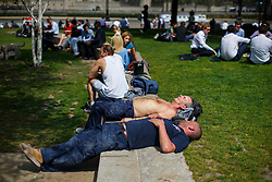 © Licensed to London News Pictures. 09/05/2016. London, UK. City workers enjoy sunshine and warm weather on their lunch breaks in Potters Fields Park near City Hall in London on Monday, 9 May 2016. Photo credit: Tolga Akmen/LNP