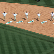 Ground staff perform YMCA while tending to the playing surface during the seventh inning stretch during the New York Yankees V Los Angeles Angels Baseball game at Yankee Stadium, The Bronx, New York. 15th March 2012. Photo Tim Clayton