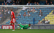 Millwall goalkeeper Jordan Archer is unable to prevent Chesterfield's Jay O'Shea from opening the scoringduring the Sky Bet League 1 match between Millwall and Chesterfield at The Den, London, England on 29 August 2015. Photo by Bennett Dean.