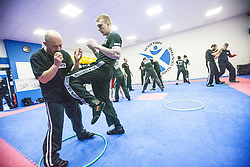 Students kneeing and fighting using the hoops, Stef Noij, KMG Instructor from the Institute Krav Maga Netherlands, takes the IKMS G Level Programme seminar today at the Scottish Martial Arts Centre, Alloa.