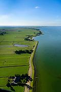 Nederland, Noord-Holland, Gemeente Edam-Volendam, 13-06-2017; Zeevangse Zeedijk, IJsselmeerdijk ten noorden van Edam.<br /> De dijk staat op de nominatie om verstrekt te worden, bewoners en actievoerders vrezen aantasting van de monumentale dijk en verlies culturele waarden.<br /> Zeevangse Zeedijk (seawall) north of Edam.<br /> The dike is nominated to be reinforced, residents and activists fear losing the monumental quality of the dike and losing other cultural values.<br /> <br /> luchtfoto (toeslag op standaard tarieven);<br /> aerial photo (additional fee required);<br /> copyright foto/photo Siebe Swart