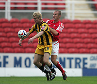 Photo: Lee Earle.<br /> Swindon Town v Port Vale. Coca Cola League 1. 08/10/2005. swindon captain Sean O'Hanlon (R) puts pressure on Gary Mulligan.