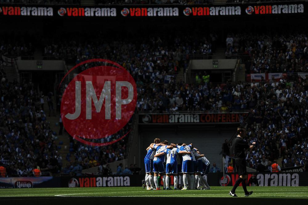 Bristol Rovers huddle before kick off - Photo mandatory by-line: Dougie Allward/JMP - Mobile: 07966 386802 - 17/05/2015 - SPORT - football - London - Wembley Stadium - Bristol Rovers v Grimsby Town - Vanarama Conference Football