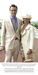 MR & MRS NICHOLAS HURD, he is the son of Lord Douglas Hurd, at a race meeting in Sussex on 3rd August 2001.ORP 16