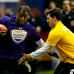 Jan 31, 2013; New Orleans, LA, USA; AFC squad Jake Delhomme grabs the flag NFC Kordell Stewart during the Tazon Latino VII flag football game at Clinic Field  inside the Ernest Morial Convention center. Super Bowl XLVII will take place between the San Francisco 49ers and the Baltimore Ravens on February 3, 2013 at the Mercedes-Benz Superdome.  Mandatory Credit: Derick E. Hingle-USA TODAY Sports