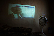 Syria. A Syrian man watch news on Al Jazeera channel into a media-center in Aleppo's province. ALESSIO ROMENZI
