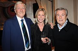 File photo dated 30/09/08 of photographer Terry O'Neill (right) with Sir Michael Parkinson (left) with photographer Terry O'Neill and his wife Laraine Ashton at a party to celebrate the publication of Parkinson's memoir at London's Holland Park. Photographer Terry O'Neill, who rose to fame with his work with the Beatles and The Rolling Stones, has died at the age of 81 at his home on Saturday following a long illness.