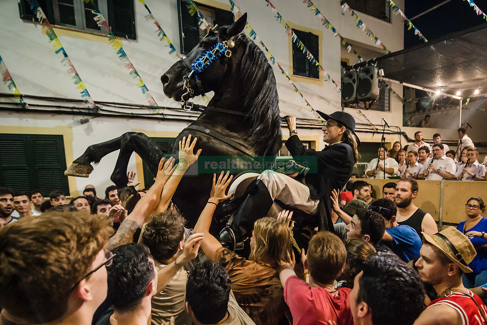 July 29, 2017 - Es Migjorn Gran, Balearic Islands, Spain - A 'caixer' (horse rider) rears up on his horse in between the cheering crowd during the 'Jaleo' of the traditional 'Sant Cristofol' (Saint Christopher) festival in Es Migjorn Gran, the town's patron saint fiesta (Credit Image: © Matthias Oesterle via ZUMA Wire)