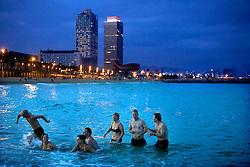 Barcelona, Catalunya,Spain.<br /> Tourist taking a bath in the sea at night.&copy; Carmen Secanella