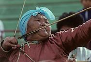 Mongolia. Ulaanbaatar. Women archery champions during the competitions that take place every year in the main stadium at Ulan Bator during the nadaam festivities for the national holiday.   /  Des femmes champions de tirs à l'arc. le Tir à l'arc est un des trois sports virils avec la course à cheval et  la lutte mongole: Pendant les compétitions  qui ont lieu chaque année dans le grand stade de Oulan Bator pour la fêté nationale du Nadaam .