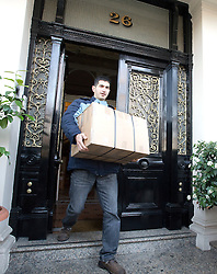 © Licensed to London News Pictures. 02/12/2011. A removal company removing boxes from the residential address of the Iranian Charge d'Affaires in London today (02/12/2011). Diplomats working at the Iranian embassy in London have been given this afternoon as a deadline to leave the UK, after the British embassy in Tehran was stormed. Photo credit: Ben Cawthra/LNP