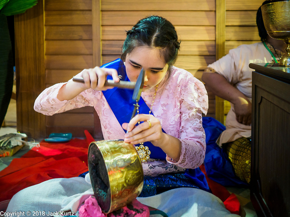 09 NOVEMBER 2018 - BANGKOK, THAILAND: A Thai craftswoman works on a brass bowl in the traditional crafts section of ICONSIAM mall in Bangkok. ICONSIAM opened November 9. ICONSIAM is a mixed-use development on the Thonburi side of the Chao Phraya River. It includes two large malls, with more than 520,000 square meters of retail space, an amusement park, two residential towers and a riverside park. It is the first large scale high end development on the Thonburi side of the river and will feature the first Apple Store in Thailand and the first Takashimaya department store in Thailand.     PHOTO BY JACK KURTZ