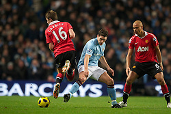 MANCHESTER, ENGLAND - Wednesday, November 10, 2010: Manchester City's Gareth Barry and Manchester United's Michael Carrick during the Premiership match at the City of Manchester Stadium. (Pic by: Chris Brunskill/Propaganda)