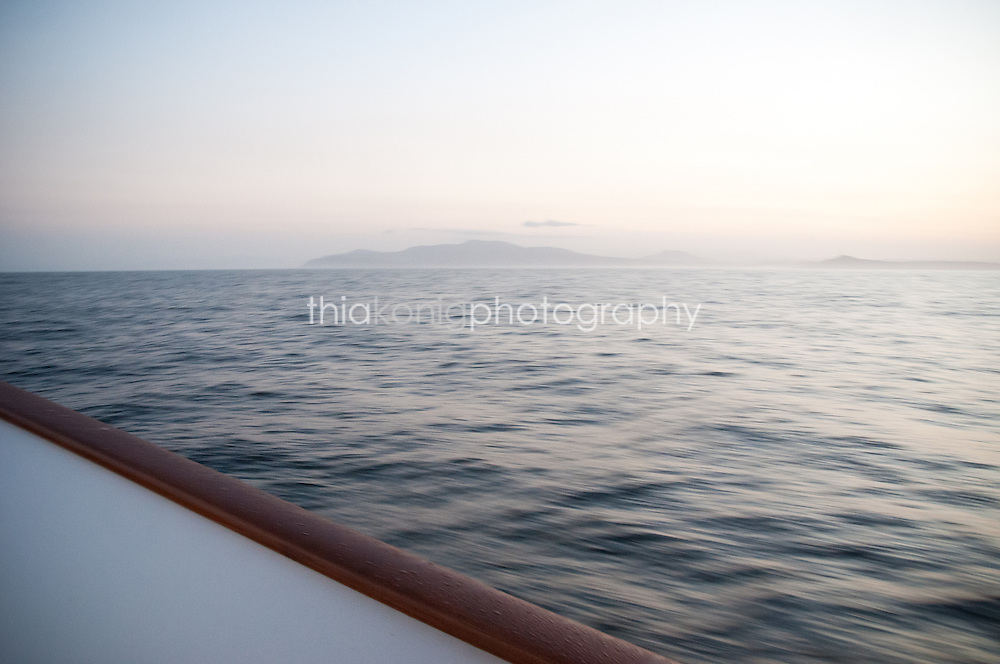 Ocean view over railing of yacht, off the coast of Baja California, Mexico