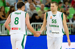 Matjaz Smodis of Slovenia and Uros Slokar of Slovenia during friendly basketball match between National teams of Slovenia and Bosnia and Hercegovina for third place at Adecco Ex-Yu Cup 2011 as part of exhibition games before European Championship Lithuania 2011, on August 9, 2011, in Arena Stozice, Ljubljana, Slovenia. Slovenia defeated BiH 59-52. (Photo by Vid Ponikvar / Sportida)