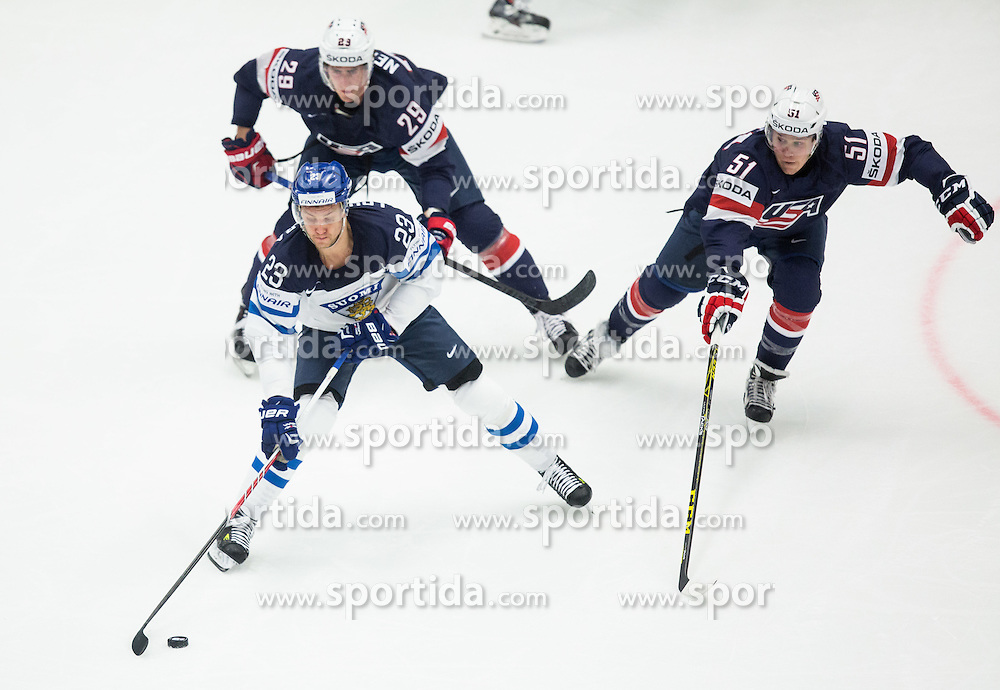 Ossi Louhivaara of Finland vs Brock Nelson of USA and Jake Gardiner of USA during Ice Hockey match between USA and Finland at Day 1 in Group B of 2015 IIHF World Championship, on May 1, 2015 in CEZ Arena, Ostrava, Czech Republic. Photo by Vid Ponikvar / Sportida