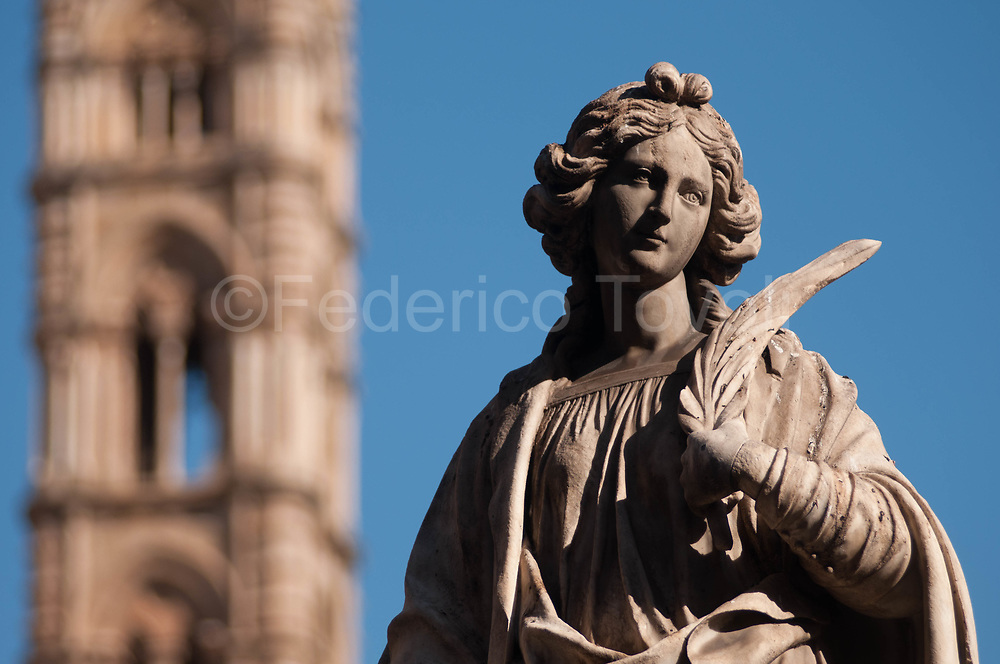 A statue of the cathedral complex of Palermo
