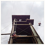 Ohio University students and their moms participate in the Mom's Weekend Zip-lining activity held on the Challenge Course located at the Ridges Sunday, April 7, 2013.