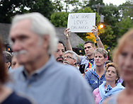 """An unidentified man holds a sign which read, """"New Hope Loves Orlando"""" during a candlelight vigil in support of the victims of the Orlando massacre Monday, June 13, 2016 in New Hope, Pennsylvania.   (Photo by William Thomas Cain)"""