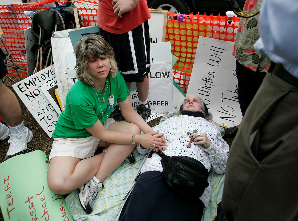 Kelly Ames (L), of Dixon, Il, prays with Patricia Devlin (R), of Lubbock, Tex. outside the Woodside Hospice on March 23, 2005 in Pinellas Park, Fla. Photo by Scott Audette/Reuters