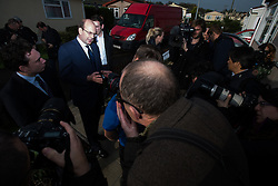 © Licensed to London News Pictures . 19/11/2014 . Kent , UK . UKIP candidate MARK RECKLESS at Hoo Marina Park in Rochester , surrounded by media , to canvas votes . The Rochester and Strood by-election campaign following the defection of sitting MP Mark Reckless from Conservative to UKIP . Photo credit : Joel Goodman/LNP