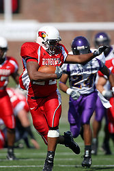 29 September 2007:  Geno Blow breaks the defense, stiff arming his way to the endzone. In action between the Northern Iowa Panthers and the Illinois State Redbirds, the Panthers chewed up the Redbirds by a score of 23 - 13. Game action commenced at Hancock Stadium on the campus of Illinois State University in Normal Illinois..