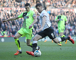 Chris Martin of Derby County and Mark Hudson of Huddersfield Town (L) in action - Mandatory byline: Jack Phillips/JMP - 05/03/2016 - FOOTBALL - iPro Stadium - Derby, England - Derby County v Huddersfield Town - Sky Bet Championship