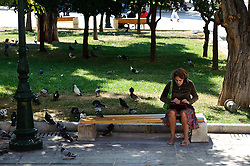THEMENBILD - Finanzkrise in Griechenland. Eine Frau sitzt auf einer Bank in einem Park nahe dem Parlament. EXPA Pictures © 2011, PhotoCredit: EXPA/ S. Zangrando