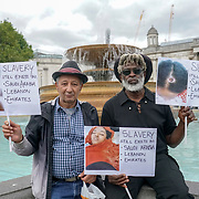 Trafalgar square, London, England, UK. 19th August 2017. A guy holding a placard written Slavery still exit in Saudi Arabia, Lebanon and Emirates.