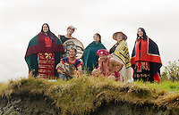 Native folk at Port Rupert dress in their traditional regalia and pose for a group portrait at Thomas Point.  Port Rupert, Vancouver Island, British Columbia, Canada.