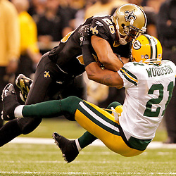 2008 November, 24: New Orleans Saints running back Deuce McAllister (26) runs over Green Bay Packers cornerback Charles Woodson (21) for a first down during a Monday Night Football game at the Louisiana Superdome in New Orleans, LA.