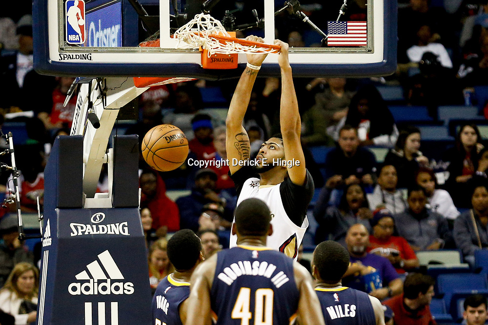 Dec 15, 2016; New Orleans, LA, USA; New Orleans Pelicans forward Anthony Davis (23) dunks over Indiana Pacers guard Glenn Robinson III (40) and forward Thaddeus Young (21) and forward C.J. Miles (0) during the second quarter of a game at the Smoothie King Center. Mandatory Credit: Derick E. Hingle-USA TODAY Sports