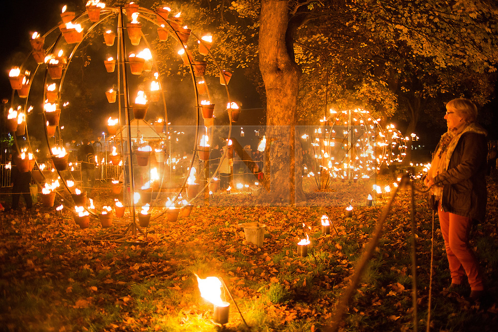 """© Licensed to London News Pictures. 01/11/2015. Leicester, UK. More than 35,000 people were estimated to have attended the annual Diwali ight switch-on which took place along the named """"Golden Mile"""" in Belgrave Road, Leicester. Pictured, the fire display in Cossington Recreation ground, part of the Diwali festival of light. Photo credit : Dave Warren/LNP"""