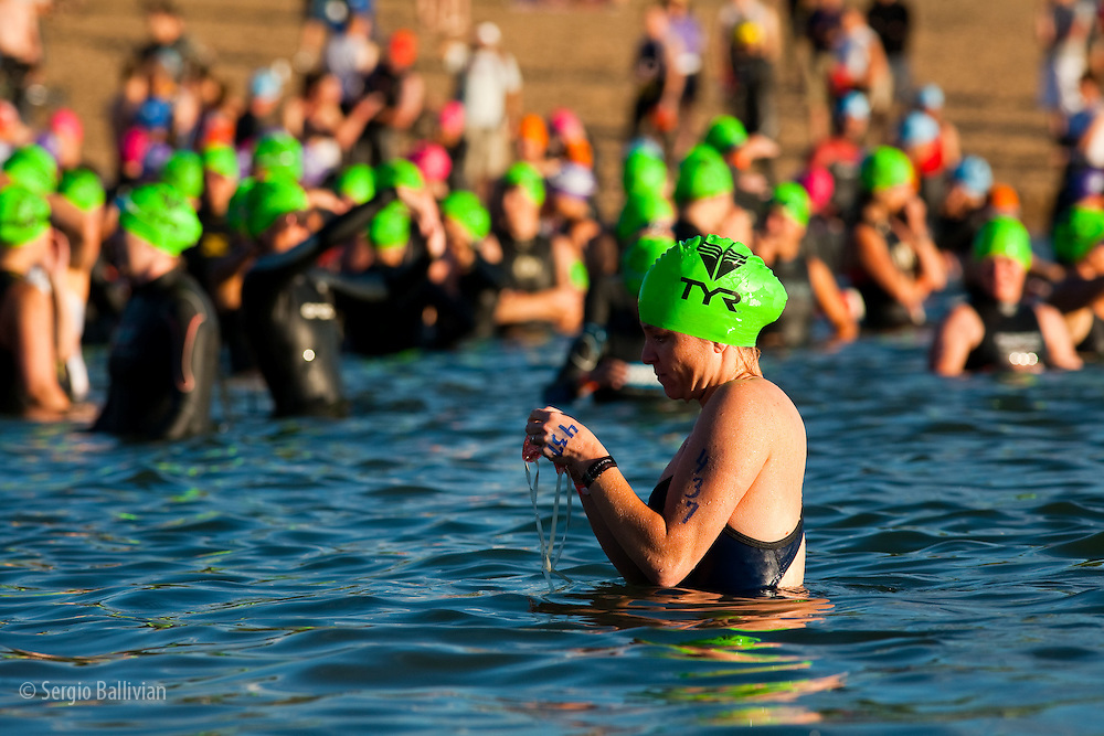 Triathletes prepare and warm-up before the swimming portion of the 5430 Triathlon at the Boulder Reservoir in Boulder, Colorado.