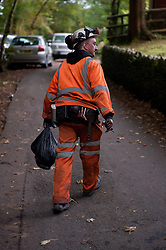 © licensed to London News Pictures  16/09/2011 .  Pontardawe,UK. ..Picture: A miner leaves the site..News of a miner found dead at the mine is broken  as an operation continues to rescue  miners trapped in a mine in the Swansea Valley. Photo credit :Aled Llywelyn/LNP