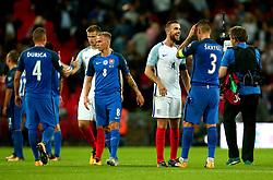 Jordan Henderson of England shares a joke with Martin Skrtel of Slovakia - Mandatory by-line: Robbie Stephenson/JMP - 04/09/2017 - FOOTBALL - Wembley Stadium - London, United Kingdom - England v Slovakia - 2018 FIFA World Cup Qualifier