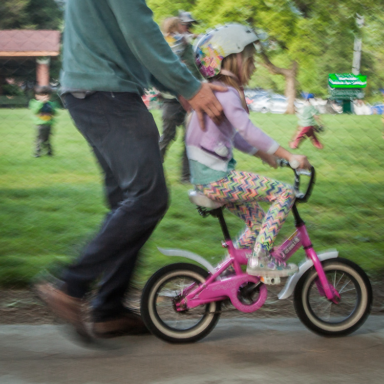 Six year old Hazel Brown receives bicycle riding instructions from her father, Thomas, on Cedar Street in Calistoga