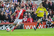 Lee Tomlin gets away from Jake Bidwell during the Sky Bet Championship Play Off Second Leg match between Middlesbrough and Brentford at the Riverside Stadium, Middlesbrough, England on 15 May 2015. Photo by Simon Davies.