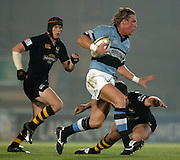 2005/06 Powergen Cup, London Wasps vs Cardiff Blues, Blues, Andy Powell, breaks withe ball, Joe Worsley putting in the flying tackle and Jonny O'Conner tracking.  Causeway Stadium, Wycome, ENGLAND, 07.10.2005   © Peter Spurrier/Intersport Images - email images@intersport-images..   [Mandatory Credit, Peter Spurier/ Intersport Images].