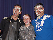Chavez High School freshman math teachers Michael Hines, left, and Karen Christianson, center, pose for a photograph with principal Rene Sanchez after getting pies in face during a rally for STAAR, March 27, 2014.