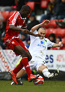 Swindon - Saturday March 20th, 2010: Michael Rose of Norwich and Frank Nouble of Swindon in action during the Coca Cola League One match at The County Ground, Swindon. (Pic by Paul Chesterton/Focus Images)