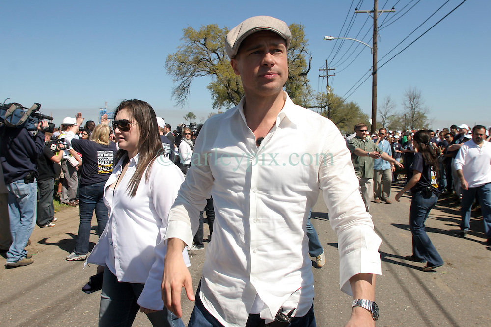 16 March 2008. New Orleans, Louisiana. Lower 9th ward.<br /> Movie star Brad Pitt with  some of the 600 volunteers for the 'Make a Difference, Make a Commitment' clean up of the neighbourhood devastated by Hurricane Katrina. The massive clean up project was organised by Brad Pitt's Make it Right Foundation aided by the Clinton Global Initiative.<br /> Photo credit; Charlie Varley.