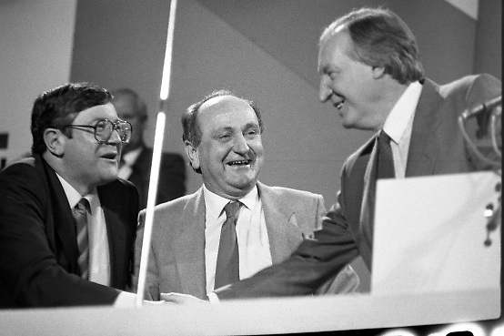 Fianna Fáil Árd Fheis.  (R31)..1986..19.04.1986..04.19.1986..19th April 1986..The Fianna Fáil party held their Árd Fheis at the Simmonscourt, RDS,Dublin over this weekend. the keynote address was given by the party leader Mr Charles Haughey TD...Image shows Mr Charles Haughey TD, Fianna Fáil party leader,being congratulated by party colleagues Ray Burke and Gerry Collins after his keynote address.