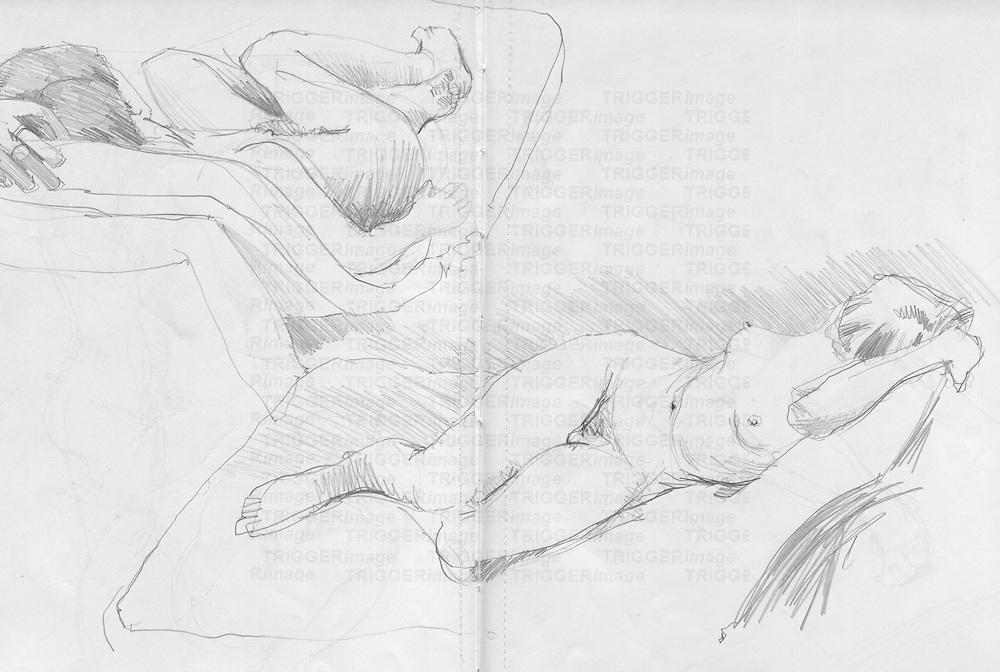 Sketchbook drawing of naked female figure lying