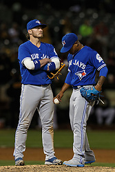 OAKLAND, CA - JULY 15:  Josh Donaldson #20 of the Toronto Blue Jays stands on the pitchers mound with Marcus Stroman #6 during the fifth inning against the Oakland Athletics at the Oakland Coliseum on July 15, 2016 in Oakland, California. (Photo by Jason O. Watson/Getty Images) *** Local Caption *** Josh Donaldson; Marcus Stroman