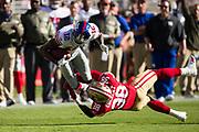 San Francisco 49ers defensive back Adrian Colbert (38) tackles New York Giants wide receiver Tavarres King (12) at Levi's Stadium in Santa Clara, Calif., on November 12, 2017. (Stan Olszewski/Special to S.F. Examiner)