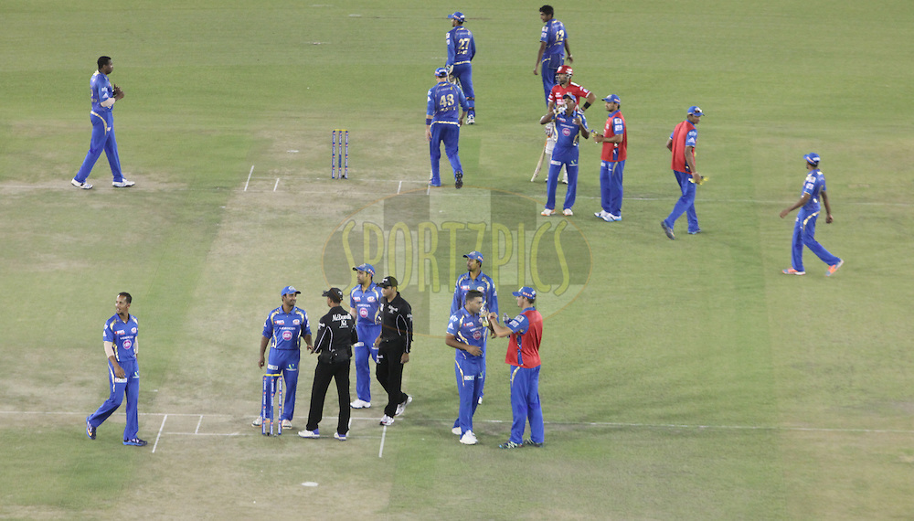 Mumbai Indians team players and umpires on ground during match 48 of the Pepsi Indian Premier League Season 2014 between the Kings XI Punjab and the Mumbai Indians held at the Punjab Cricket Association Stadium, Mohali, India on  the 21st May  2014<br /> <br /> Photo by Arjun Panwar / IPL / SPORTZPICS<br /> <br /> <br /> <br /> Image use subject to terms and conditions which can be found here:  http://sportzpics.photoshelter.com/gallery/Pepsi-IPL-Image-terms-and-conditions/G00004VW1IVJ.gB0/C0000TScjhBM6ikg