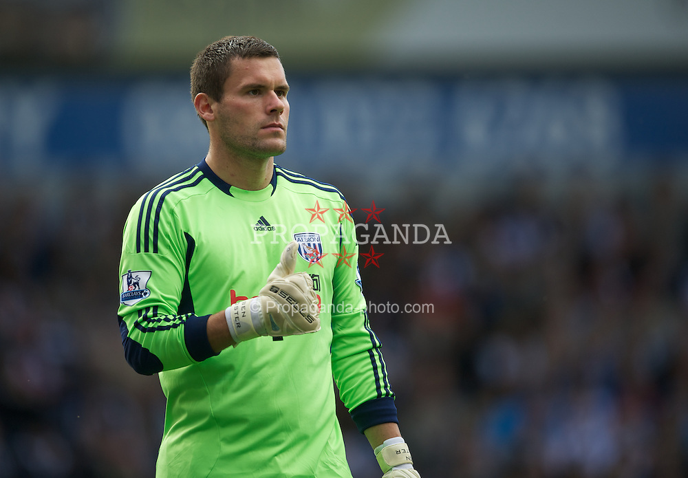 WEST BROMWICH, ENGLAND - Sunday, August 28, 2011: West Bromwich Albion's goalkeeper Ben Foster looks dejected after his mistake in the last minute handed victory to Stoke City during the Premiership match at the Hawthorns. (Pic by David Rawcliffe/Propaganda)